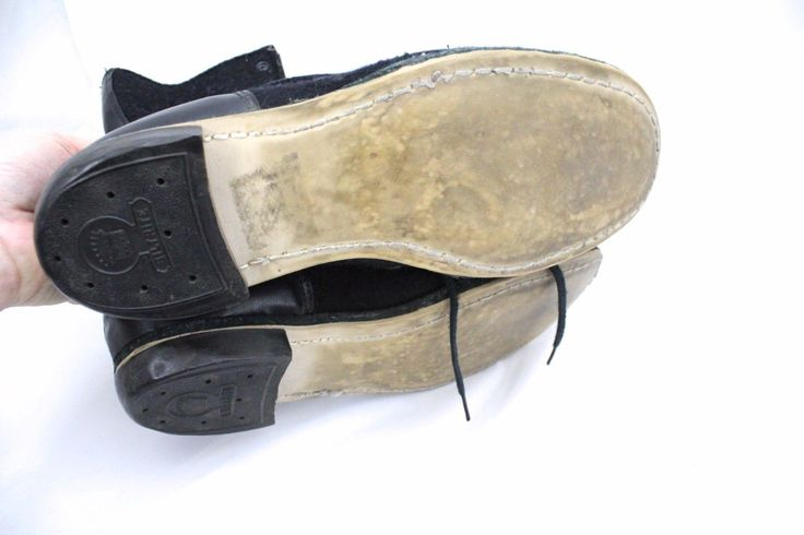 "Interesting boots, maybe ski boots?. They are of boiled wool in black, with vinyl trim in black and soles that I don't think are leather. The uppers seem worn but the soles are new. Circumference of boot top: 10"". 