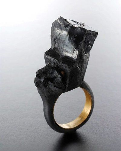 """rings for planet Earth  - Claudia Cucchi - """"Il RISVEGLIO""""  Black - 2012  New Frequency  The slowdown  The rain  The lightning  Heat  the dark  Zone nothing  The final rest"""