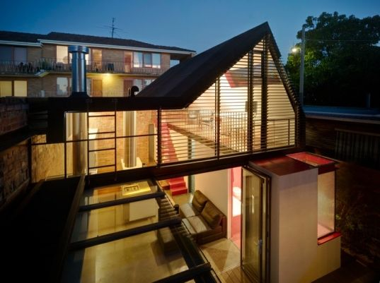 In Melbourne, long before city planning regulations were set into place, houses like this Victorian took advantage and built tall boundary walls. So when the owners of this house wanted to renovate their historic home, they were able to play off the non-standard