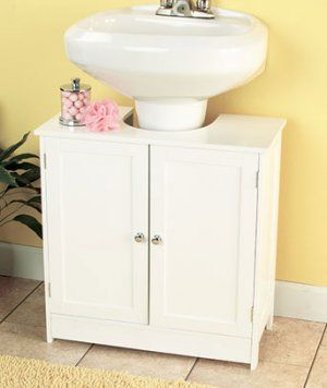 Pedestal Sink Cabinet: I WANT THIS, but they only sell an espresso colored one in the US. I think my daddy could make one.