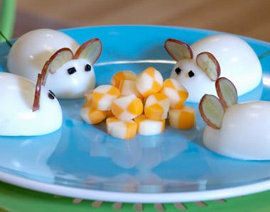 Egg mice snack. Cut the eggs in half and cut thin grape slices as ears.