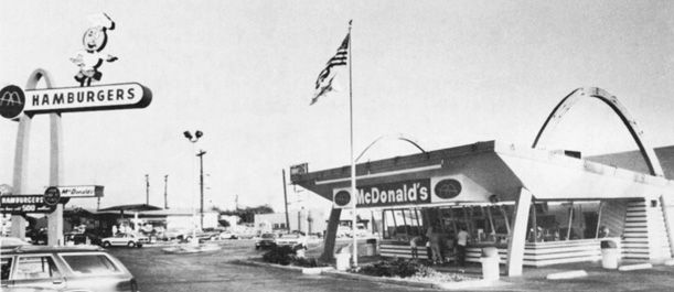 """""""The Golden Arches of McModernism"""" -- The McDonald's aesthetic. """"In the early 1950s Richard and Maurice McDonald hired architect Stanley Clark Meston to design a drive-in hamburger stand that carried on the traditions of roadside architecture established in the 1920s and 1930s. In an age before ubiquitous mass media advertisements, the building was the advertisement. Meston made the entire building a sign specifically designed to attract customers from the road""""."""