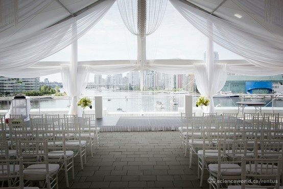 Full set-up with an empty house. White and green theme, playing off the background of Vancouver's city skyline and the nature that surrounds it. Science World weddings. Vancouver, BC.
