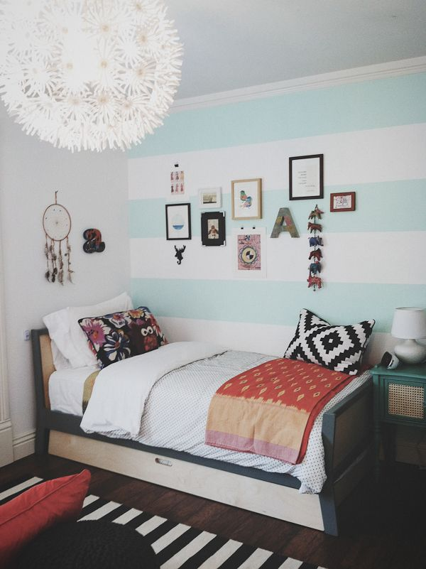 tribal meets bohemian! Seafoam green, tribal, stripes, and dream catcher!! Everything I'm looking for in a room! Love!! The only thing I'd change is I would add more color to the walls and do a fun head board.