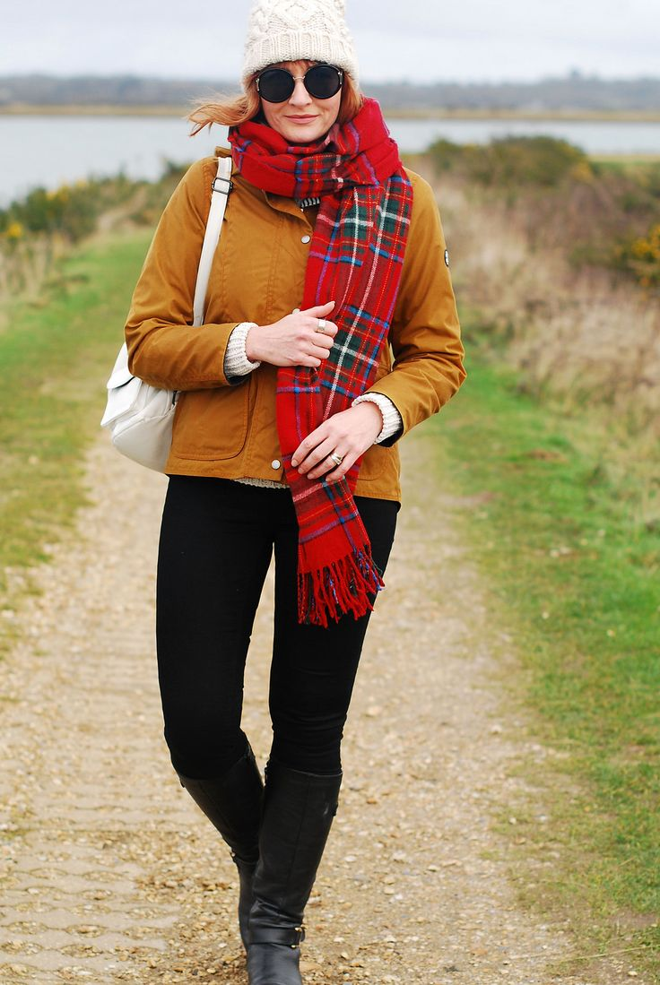 Cold weather preppy outfit for the coast: Brown Barbour jacket  cream bobble hat and roll neck  red tartan scarf  black skinnies and riding boots   Not Dressed As Lamb, over 40 style blog