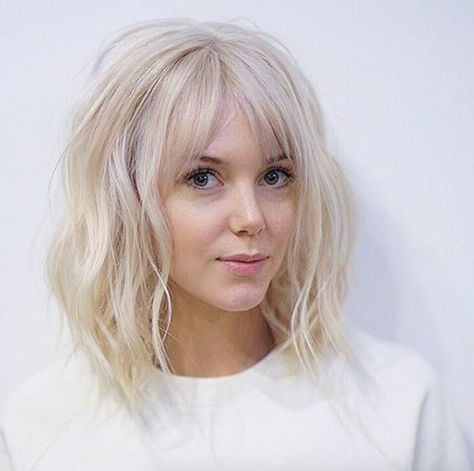 Baby blonde lob with bangs by Tim Morrison