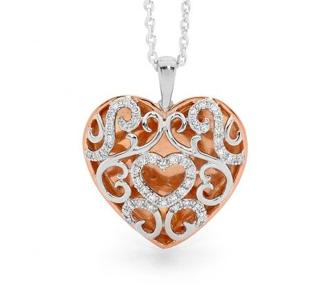 This statement pendant is made in sterling silver with high polish rose gold plating to add to its beauty and wearability. The pendant is open and lightweight with the filigree pattern on the front is set with 0.20ct of sparkling white diamonds.
