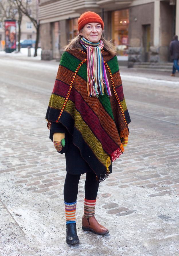 """Hanna, 50   Hanna, 50"""" Finnish street style 2013, I'm wearing my daughter's hat, a 10 year old poncho, self-made gloves and socks and shoes I bought about 15 years ago in Salo… I think I don't need to buy new clothes anymore. I have everything I need for the rest of my life."""""""