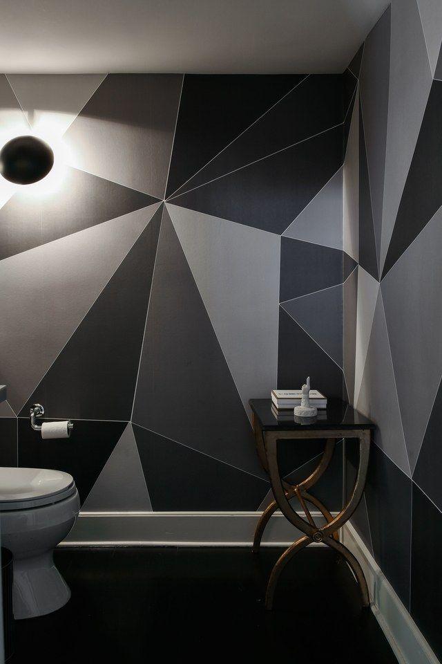 A graphic bathroom in Cole & Son wallpaper.