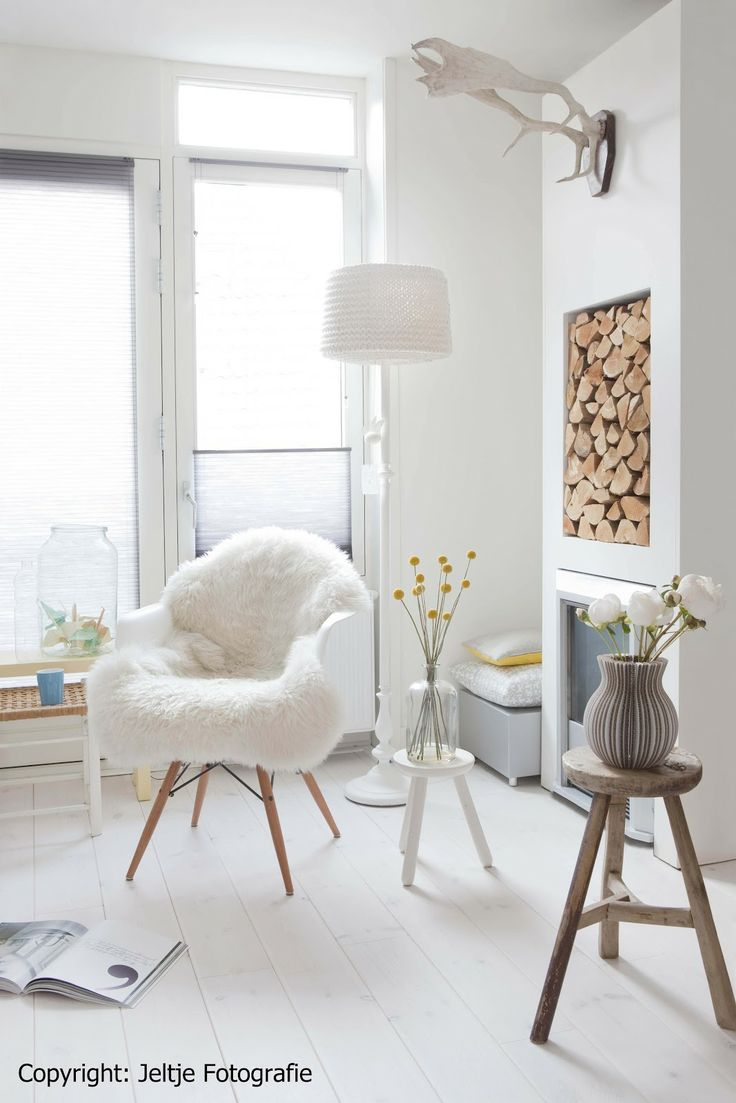 White wooden floor (I just yearn to rip out our grey carpet now...). Great chair and styling!