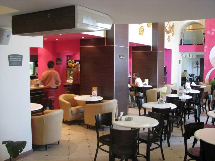 http://taizh.com/wp-content/uploads/2014/11/Elegant-cafe-interior-design-with-white-round-sall-table-plus-black-chair-aswell-pink-white-painting-wall-decor-also-brown-ceramic-tile-floor.jpg
