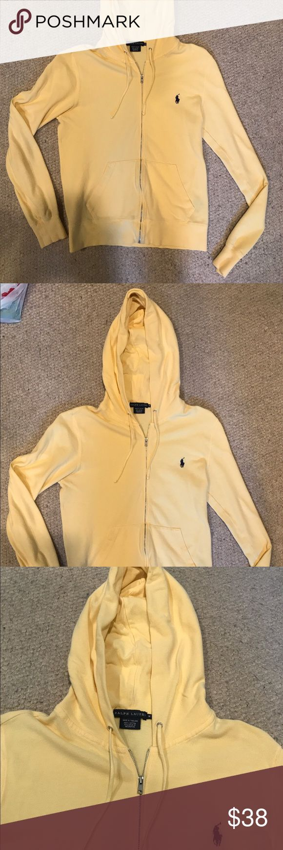 Ralph Lauren Yellow Zip Up Hoodie I'm selling a super soft, yellow zip-up hoodie by Ralph Lauren. I got it as a gift but only wore it 4-5 times. The hoodie shows no sign of wear. It has a hood and is great for staying cozy when it rains outside. EUC. Ralph Lauren Tops Sweatshirts & Hoodies