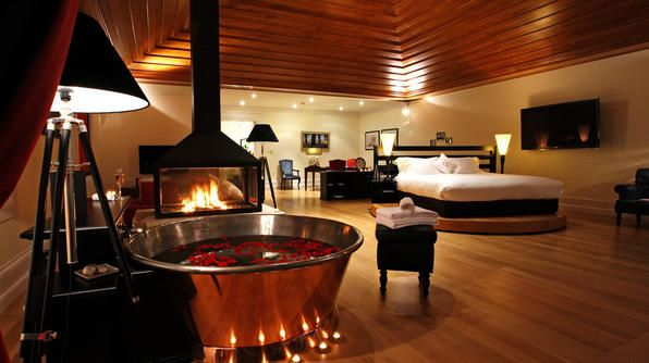 """Portugal has recently topped the list as a honeymoon destination. Indulge yourselves with a stay at <a href=""""http://www.the-yeatman-hotel.com"""" target=""""_blank"""">The Yeatman</a> hotel in the city of Porto, and try The Bacchus Suite (featured here). Amenities include a double walk-in shower and sliding doors that open onto a private terrace with dining options for 2 or more."""
