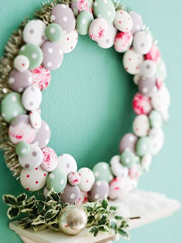 Button Wreath!  Make use of your fabric scraps by constructing this whimsical wreath. Cover buttons with fabric scraps, securing on the backside of the button with hot-glue. Wrap a plastic foam wreath with ribbon and trim the outside edge of the wreath tinsel. Then glue the buttons to the wreath, layering and overlapping as desired.
