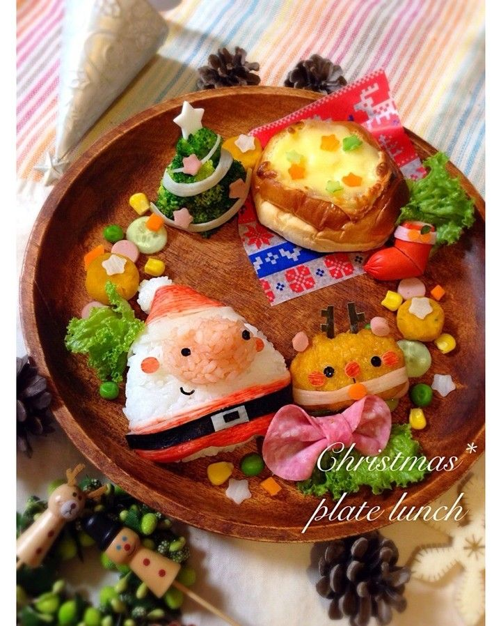 Cute Christmas deco food platter, featuring rice Santa Claus and inari sushi reindeer