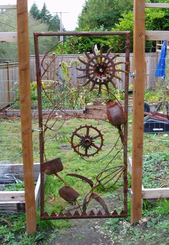 Garden Gate  -  Could easily use a twin bed frame with springs and attach various rusty metal garden related implements to it.  Love this!
