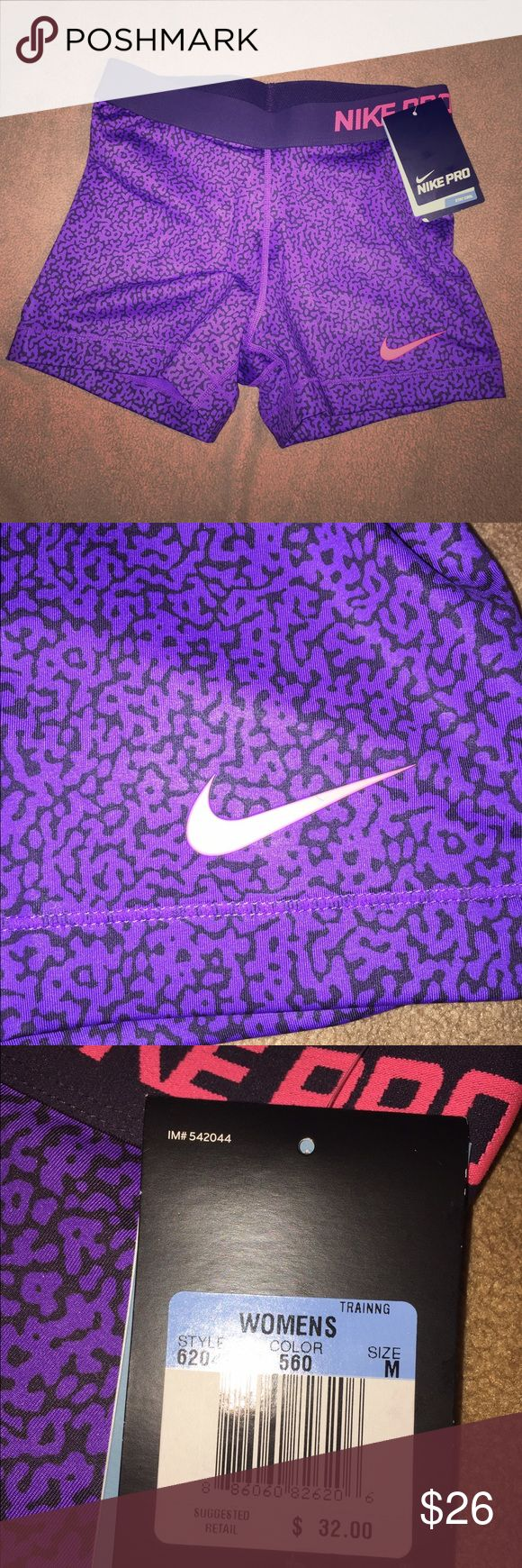 NWT new Nike Pro women's spandex shorts purple m BRAND NWT- Nike Pro women's spandex size medium. Retails for $32, price firm when bought alone. Bundle for a better deal :) Nike Shorts
