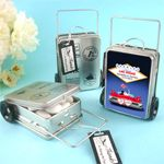 How cute! Mini rolling suitcases personalized as table cards for a travel themed party