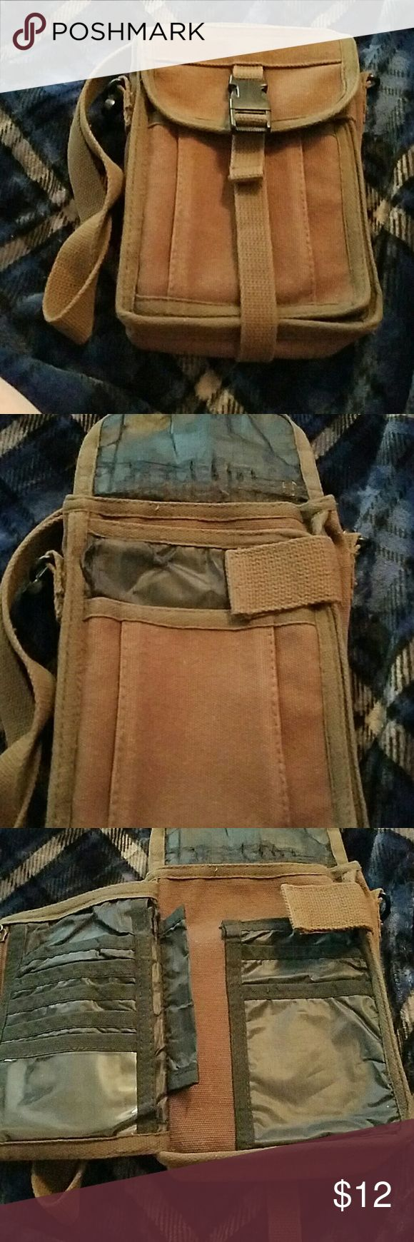 Canvas Crossbody bag Brown crossbody bag. Has several compartments. Inside top lining shows sign of wear as shown in picture 2. Needs to be thrown in washer, no other issues. Bags Crossbody Bags