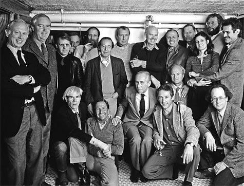 New York, 1982, 25th Anniversary Lunch of Castelli Gallery at The Odeon. Standing left - right: Ellsworth Kelly, Dan Flavin, Joseph Kosuth, Richard Serra, Lawerence Weiner, Nassos Daphnis, Jasper Johns, Claes Oldenberg, Salvatore Scarpitta, Richard Artschwager, Mia Westerlund Roosen, Cletus Johnson, Keith Sonnier Seated left - right: Andy Warhol, Robert Rauschenberg, Leo Castelli, Ed Ruscha, James Rosenquist, Robert Barry.  Photo: Hans Namuth: Art Studios, Warhol, Great Artists, Photo Artists, 24 7 Human, Artists Portraits, Artist Pic, Anniversary Lunch