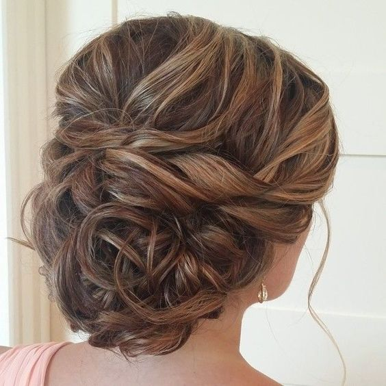 updo wedding hairstyle via heather ferguson