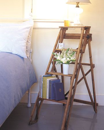 Stepladder Bed Stand - SO my style  Take advantage of every bit of bedroom space by stacking your nighttime necessities instead of crowding them on top of a tiny stand. The four wide rungs of an extra stepladder provide a steady spot for a row of books as well as the necessary alarm clock and reading lamp.
