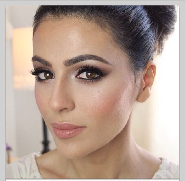 Statement eyes and strong arched brows with soft cheeks and lips