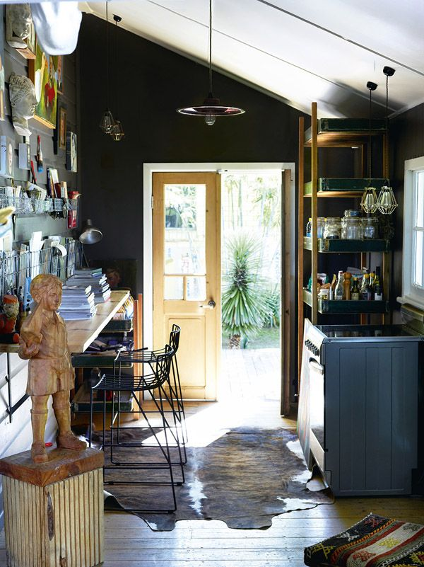 Bold, beautiful, black walls create a surprisingly inviting space.  Elegant and casual at the same time. (BromleyYugeHouse-backdoor- The Design Files)
