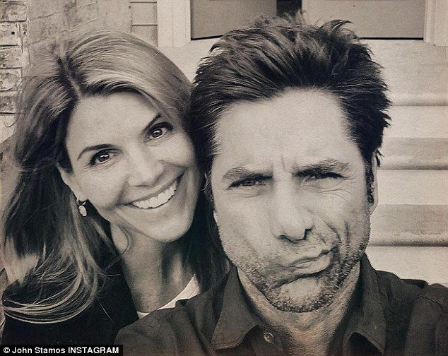 Return: John Stamos is back as the beloved Uncle Jesse for the Netflix sequel series, Fuller House, set to be released in 2016; pictured with Lori Loughlin on the set