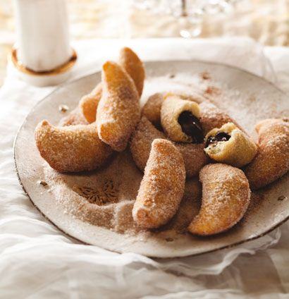 Warm chocolate beignets in cinnamon sugar