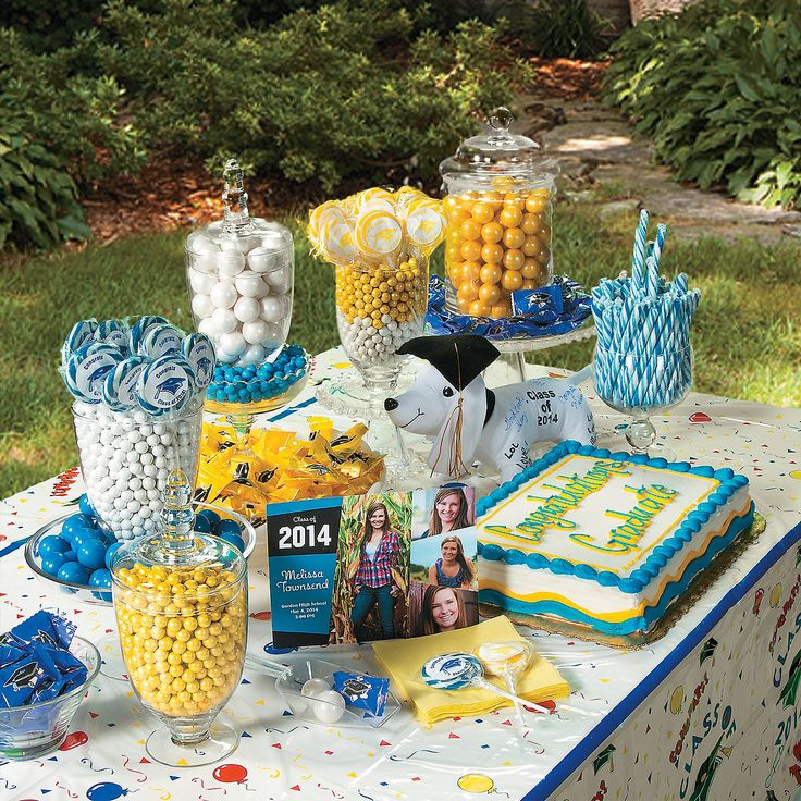 sweeten up your graduation party with a candy buffet in the grads school colors party guests will give this candy buffet an a for style thanks to a