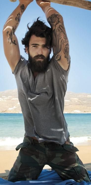 Men and beards and tattoos and being fit and I want to have this mans babies...lol :)