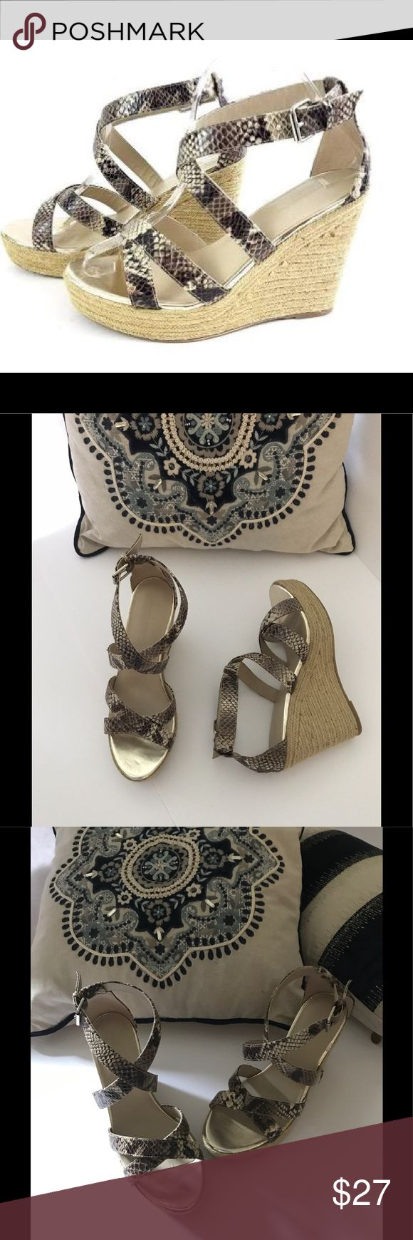 """Banana Republic Snake Print Espadrille Wedge Banana Republic snake print strappy espadrille platform jute wedge. Excellent condition, no signs of wear. Only flaw is a small place where glue discolored on the jute as shown in last pic, but very minor & not noticeable. No box. Heel height approx 4.5"""", platform approx 1"""". Clean, non-smoking home. I package to protect your purchase. 5⭐️avg rated seller; ship within 1 day after purchasing. 30% bundle discount on just 2 or more. Banana Republic…"""