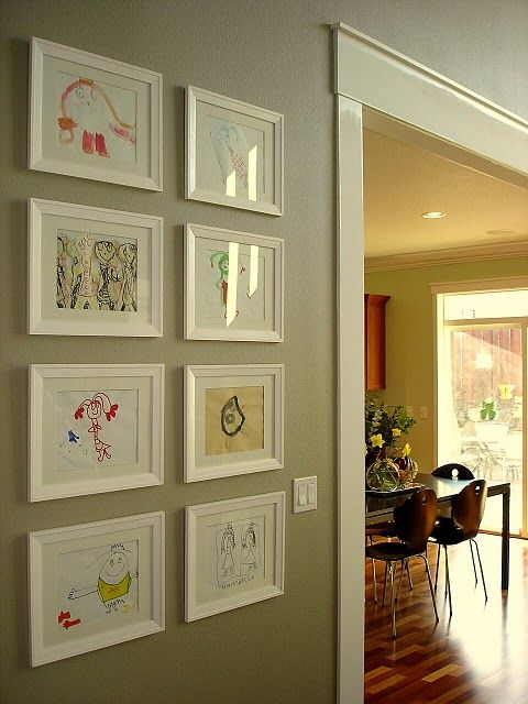 Great display idea for kid's artwork. Love white frames!