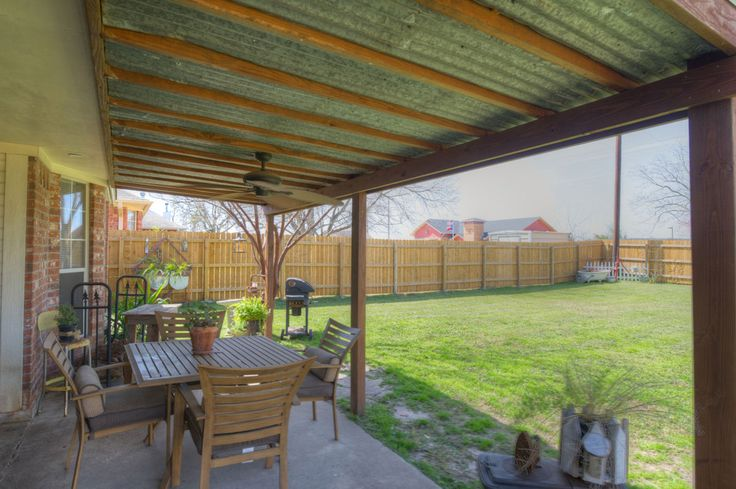 The spacious covered back porch is the perfect place to have a cookout with guests or to simply enjoy a Texas evening outdoors.