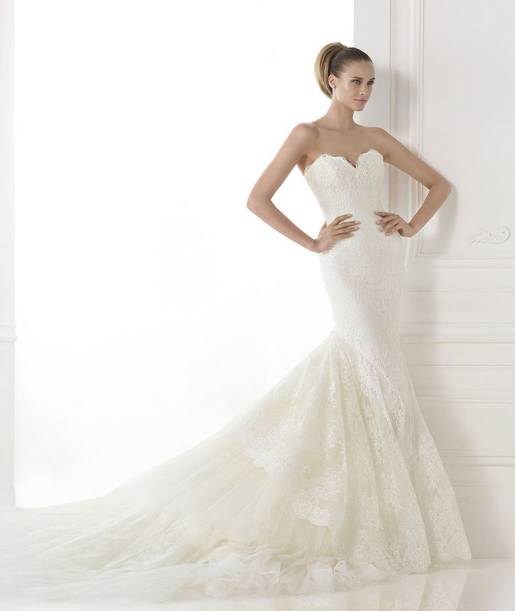 CALLIDO, Pronovias Atelier 2015 Love the skirt and train, pattern of the lace. Looks perfect for a summery outdoor venue.