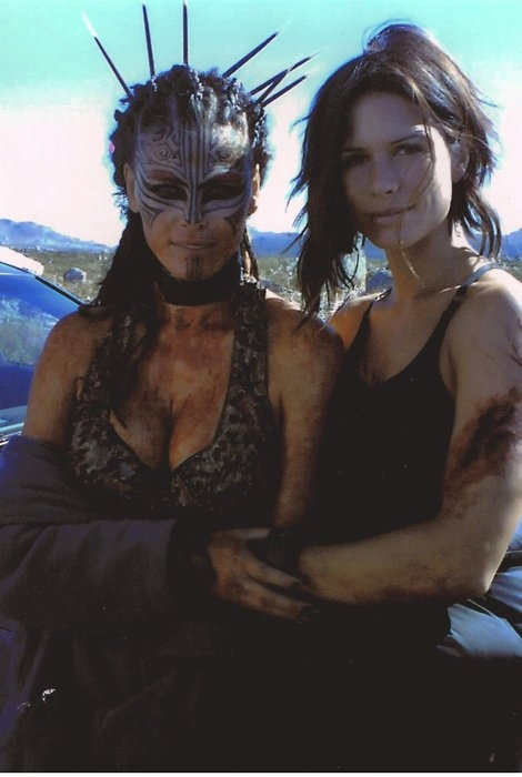 So wanting Rhona Mitra's (on right) haircut...only maybe a few longer pieces...what do you think?