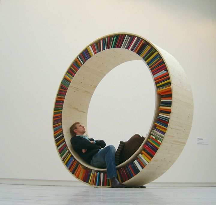 """A circular bookshelf designed by David Garcia for his """"Archive Series."""" Garcia aims to blur """"the borders between art and design."""" (via iGNANT)"""