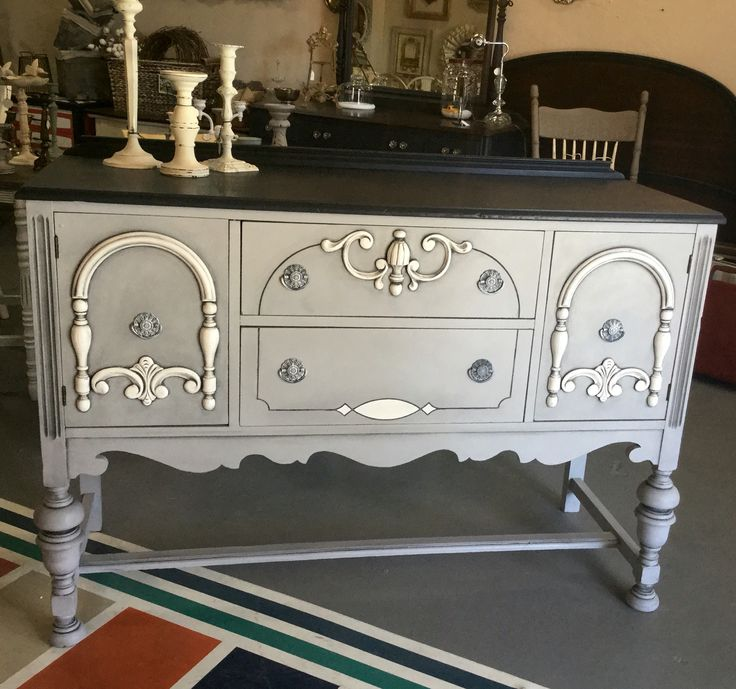This lovely little buffet has all the ornate details girls like me live for!! I chose Paris Grey, Graphite, and Pure White Chalk Paint® by Annie Sloan, and opted for a Graphite wash in the detail in leau of dark wax. I love the versatility of this paint!! A nice coat of clear Soft Wax to protect the paint, and she's done!! :)