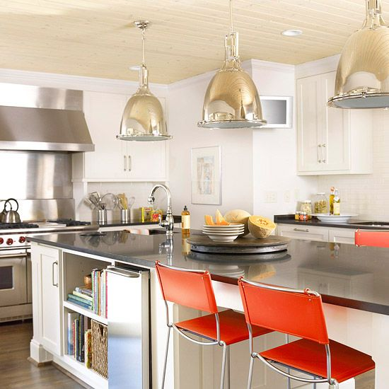 Blank Slate - White kitchen cabinets and fixtures partner with sleek stainless steel and glass, blurring the line between contemporary and traditional in this kitchen.