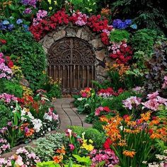 Colorful flowers line a garden path.