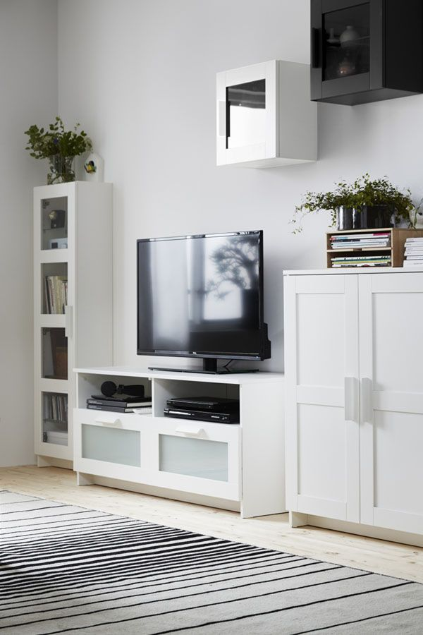 The IKEA BRIMNES TV unit has large drawers that make it easy to keep remote controls, game controllers and other TV accessories organized. Cable outlets make it easy to lead cables and cords out the back so they're hidden from view but close at hand when you need them.
