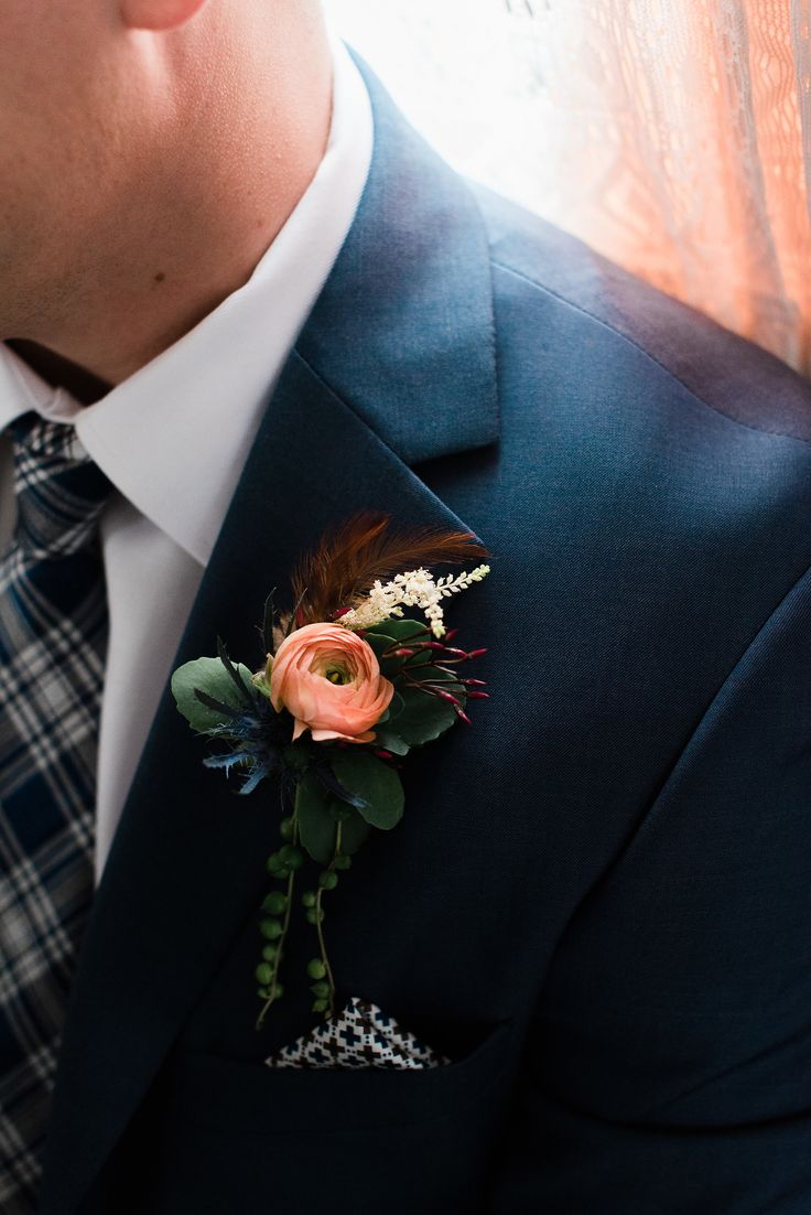 wedding- Men's Boutonniere  I loved creating the design for The Chateau At Feather Creek. Added the feather just ties it all together.  Floral Design by Lilygrass Floral and Decor in Oklahoma City, OK Suit by Pinpoint Resource also in OKC, OK
