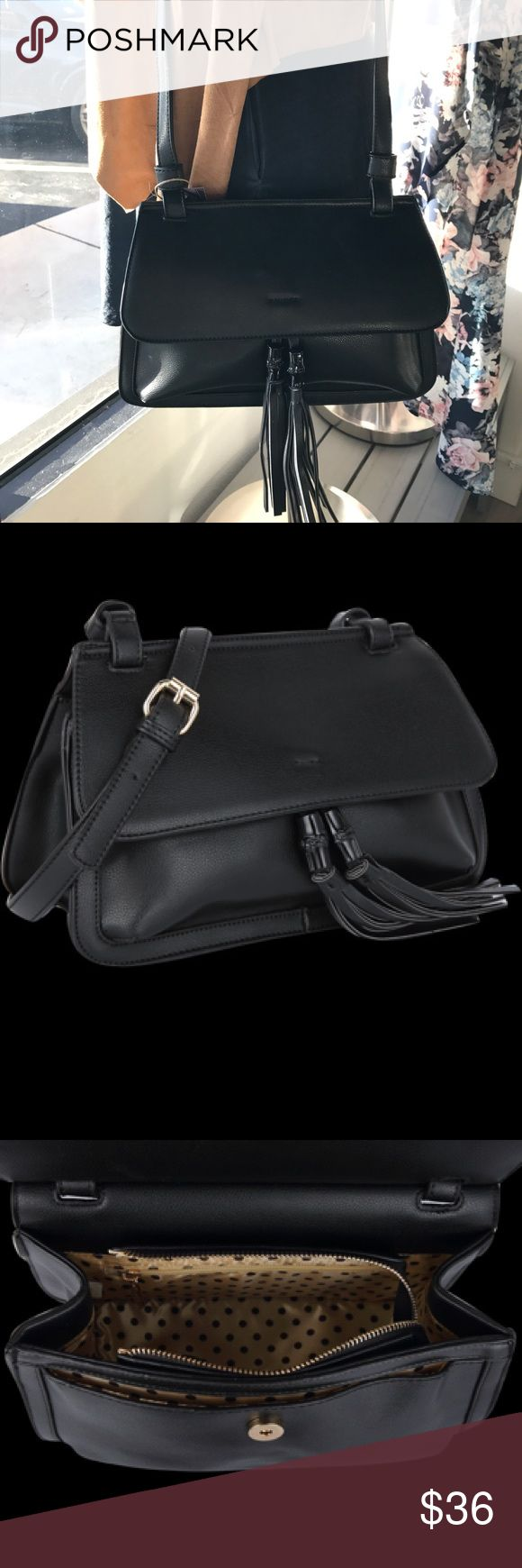 Estelle Purse This black with tassels luxury vegan handbag with adjustable strap is by Melie Bianco and features a gold and brown polka dot satin lining, front pocket and zipper closure. Melie Bianco Bags Shoulder Bags