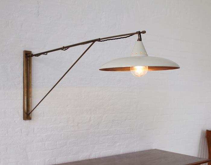 Julian Chichester - Soho Lamp A faithful copy of a mid 20th century French arm wall lamp in solid brass. Integral shade. DIMENSIONS: Small W350 x D350 x L870 Large W450 x D450 x L1420 -------------------------------------------------------------------------------- FINISHES Antique Brass & Cream