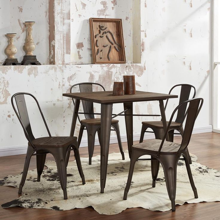 The Modus 5pc Dining Set in Gunmetal from !nspire is so on-trend this season. Shown here in a  rustic setting, our vendors are having a hard time keeping this one in stock!
