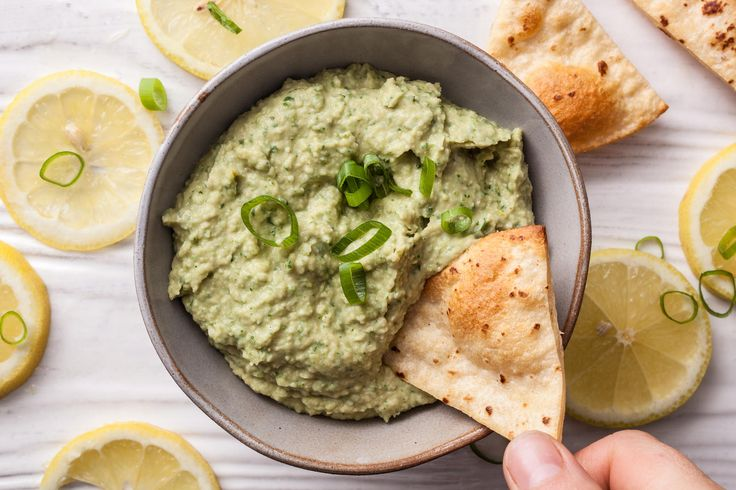 Try this easy white bean hummus recipe. To start you'll need garlic cloves, fresh parsley, scallion, cannellini beans, tahini, lemon juice, and salt.