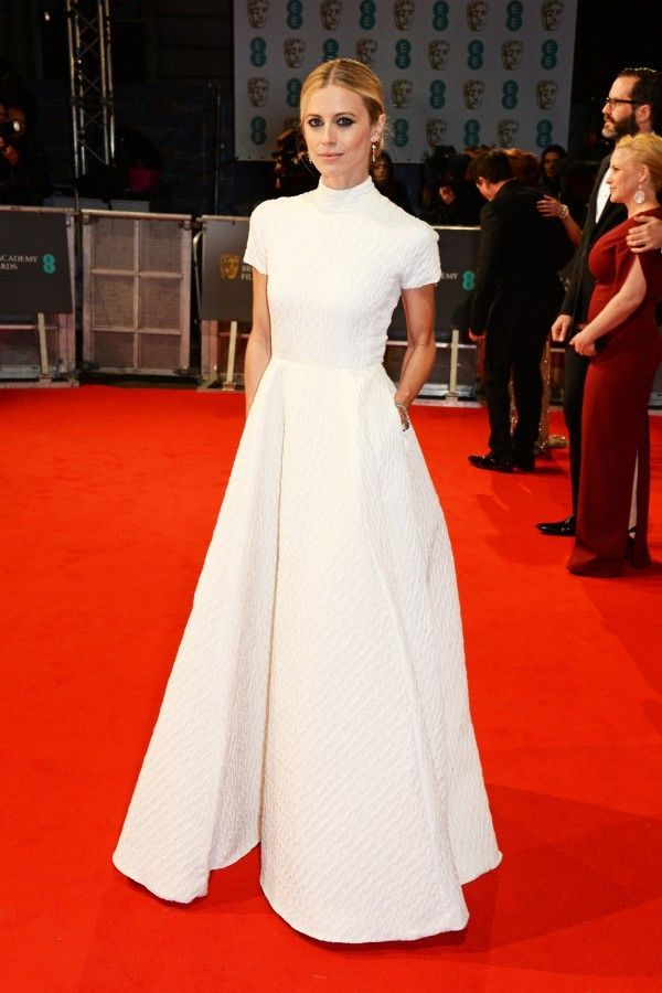 Laura Bailey in Emilia Wickstead. White simple long dress with short sleeves.