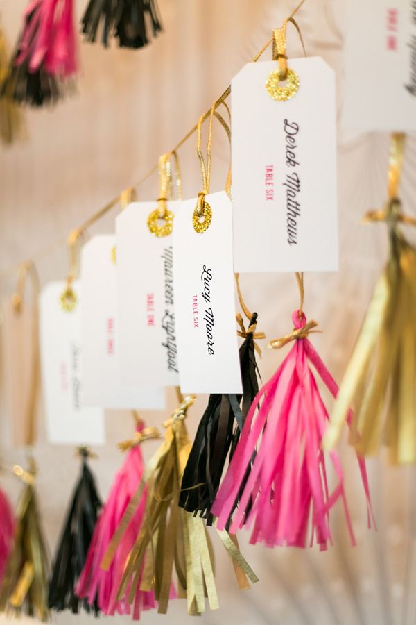 escort cards + tassels, photo by Anneli Marinovich Photography http://ruffledblog.com/kate-spade-inspired-wedding-event #escortcards #garlands #seatingchart