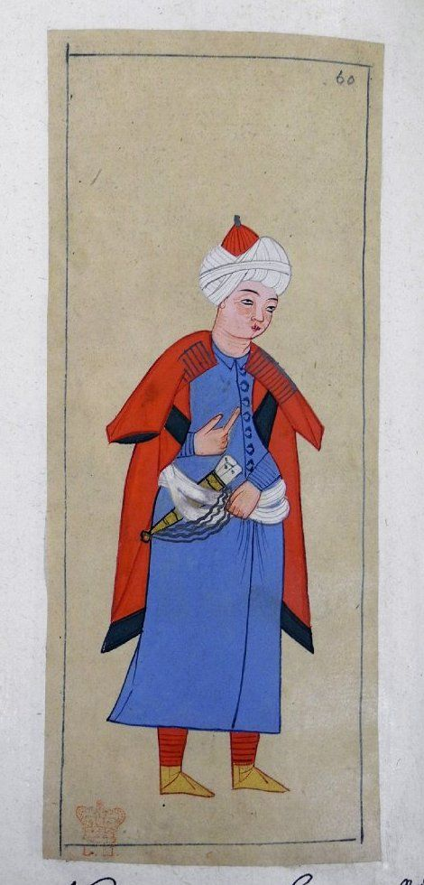 Re'îs. Captain of a ship or a galley. Wearing a red kaftan with silver frogging. Blue robe, white kuşak to which a dagger in a gold scabbard is attached by a long cord, red trousers and yellow ankle boots. Tightly wound white turban with a red cap.